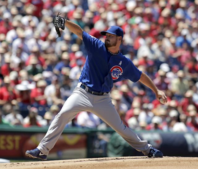 Chicago Cubs starting pitcher Travis Wood throws against the Philadelphia Phillies in the first inning of a baseball game on Sunday, June 15, 2014, in Philadelphia. (AP Photo/H. Rumph Jr)