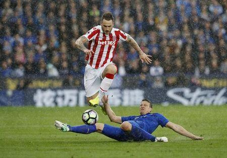 Stoke City's Marko Arnautovic in action with Leicester City's Robert Huth