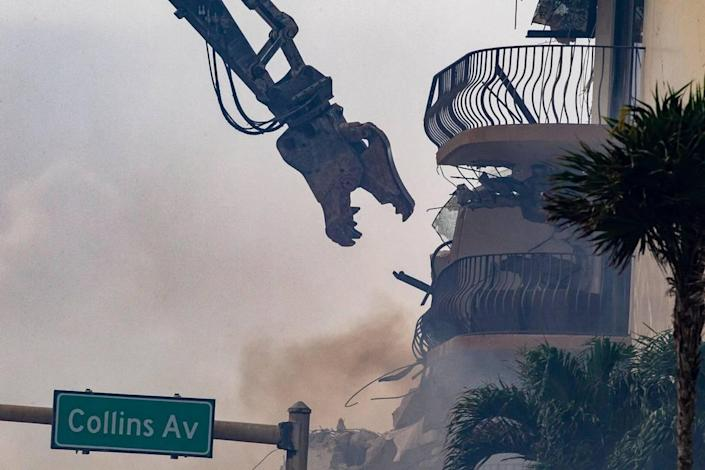 Miami-Dade County Fire Rescue crews uses heavy machinery early Friday morning as they work on the piles of rubble of the Champlain Towers South Condo, located at 8777 Collins Avenue in Surfside, that collapsed Thursday morning, on Friday, June 25, 2021.