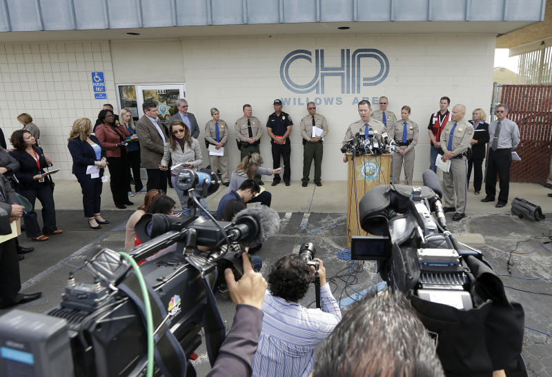 California Highway Patrol Multidisciplinary Accident Investigation Team Lt. Scott Fredrick, center right, speaks at a news conference in Willows, Calif., Friday, April 11, 2014. At least ten people were killed and dozens injured in the fiery crash between a FedEx truck and a bus carrying high school students on a visit to a Northern California College. (AP Photo/Jeff Chiu)