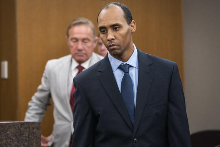 FILE - In this Friday, June 7, 2019 file photo, Former Minneapolis police officer Mohamed Noor walks to the podium to be sentenced at Hennepin County District Court in Minneapolis, before being sentenced by Judge Kathryn Quaintance in the fatal shooting of Justine Ruszczyk Damond. When the Minnesota Supreme Court overturned the third-degree murder conviction of Mohamed Noor, a former Minneapolis police officer who shot and killed a 911 caller, questions were raised about how it might affect three former officers charged in George Floyd's death. (Leila Navidi/Star Tribune via AP, Pool, File)