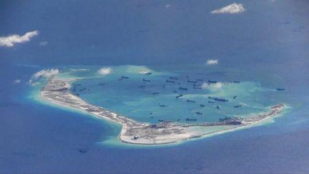 FILE PHOTO -  Still image from United States Navy video purportedly shows Chinese dredging vessels in the waters around Mischief Reef in the disputed Spratly Islands