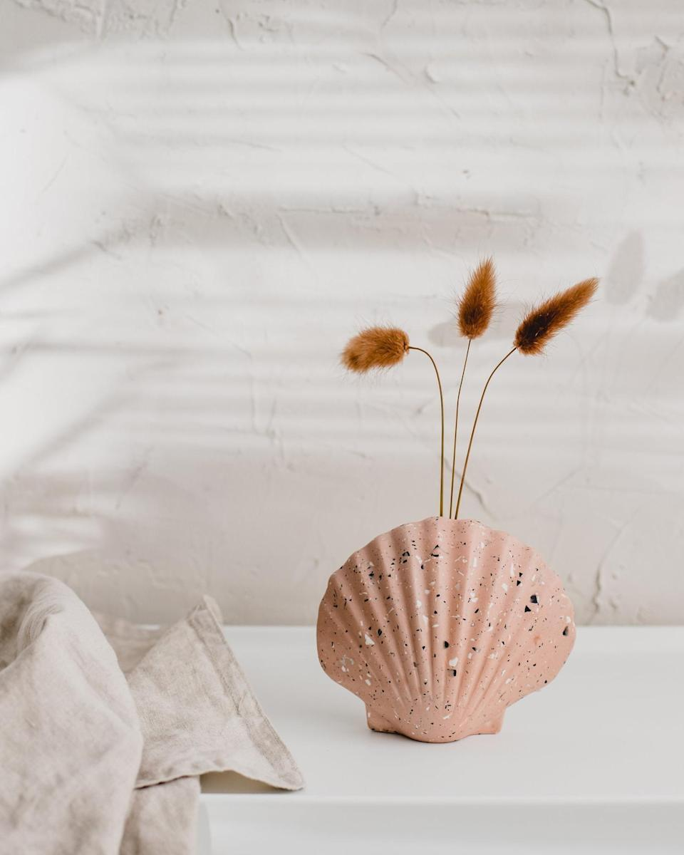 <p>This <span>Badger and Birch Scallop Terrazzo Vase</span> ($46) cannot not get noticed, whether they place it on their long table or over a stack of books on their desk. Does anyone else think of beach days when they see it?</p>