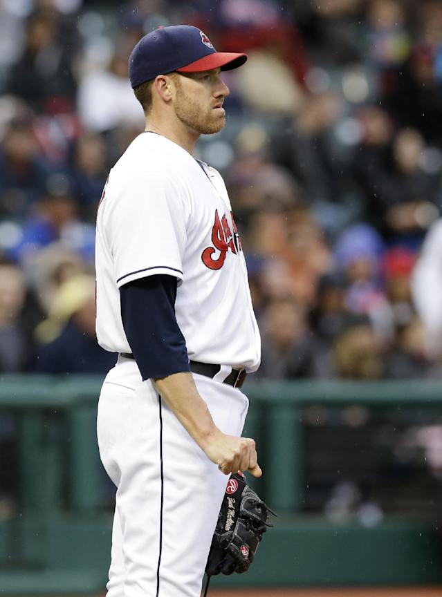 Cleveland Indians starting pitcher Zach McAllister watches a grand slam by Oakland Athletics' Josh Reddick in the second inning of a baseball game, Friday, May 16, 2014, in Cleveland. (AP Photo/Tony Dejak)