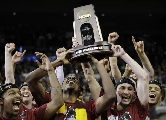 Loyola-Chicago players celebrate a regional final NCAA college basketball tournament game against Kansas State, Saturday, March 24, 2018, in Atlanta. Loyola-Chicago won 78-62. (AP)