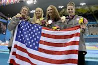 """From right, United States' <a href=""""http://sports.yahoo.com/olympics/swimming/missy-franklin-1132902/"""" data-ylk=""""slk:Missy Franklin"""" class=""""link rapid-noclick-resp"""">Missy Franklin</a>, <a href=""""http://sports.yahoo.com/olympics/swimming/dana-vollmer-1130693/"""" data-ylk=""""slk:Dana Vollmer"""" class=""""link rapid-noclick-resp"""">Dana Vollmer</a>, <a href=""""http://sports.yahoo.com/olympics/swimming/shannon-vreeland-1289874/"""" data-ylk=""""slk:Shannon Vreeland"""" class=""""link rapid-noclick-resp"""">Shannon Vreeland</a> and <a href=""""http://sports.yahoo.com/olympics/swimming/allison-schmitt-1133648/"""" data-ylk=""""slk:Allison Schmitt"""" class=""""link rapid-noclick-resp"""">Allison Schmitt</a> pose with their gold medals for the women's 4x200-meter freestyle relay swimming final at the Aquatics Centre in the Olympic Park during the 2012 Summer Olympics in London, Wednesday, Aug. 1, 2012. (AP Photo/Matt Slocum)"""