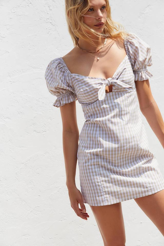 """<p>Wear this <a href=""""https://www.popsugar.com/buy/UO%20Katie%20Gingham%20Tie-Front%20Mini%20Dress-472588?p_name=UO%20Katie%20Gingham%20Tie-Front%20Mini%20Dress&retailer=urbanoutfitters.com&price=69&evar1=fab%3Aus&evar9=46422677&evar98=https%3A%2F%2Fwww.popsugar.com%2Ffashion%2Fphoto-gallery%2F46422677%2Fimage%2F46422678%2FUO-Katie-Gingham-Tie-Front-Mini-Dress&list1=shopping%2Cfall%20fashion%2Curban%20outfitters&prop13=mobile&pdata=1"""" rel=""""nofollow"""" data-shoppable-link=""""1"""" target=""""_blank"""" class=""""ga-track"""" data-ga-category=""""Related"""" data-ga-label=""""https://www.urbanoutfitters.com/shop/uo-katie-gingham-tie-front-mini-dress?category=womens-new-arrivals&amp;color=015&amp;quantity=1&amp;type=REGULAR"""" data-ga-action=""""In-Line Links"""">UO Katie Gingham Tie-Front Mini Dress</a> ($69) with a denim jacket.</p>"""