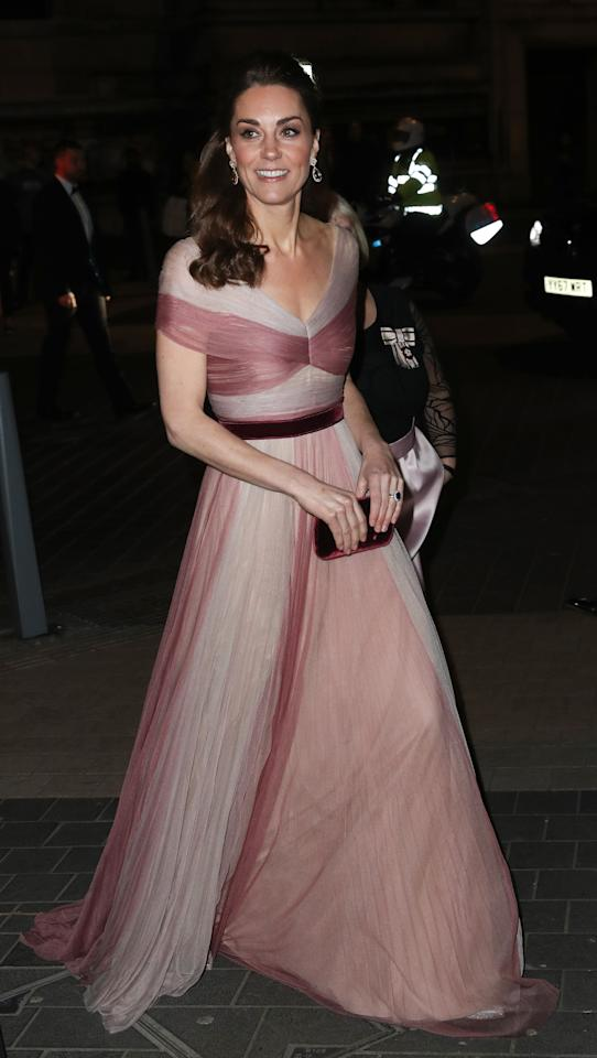 "<p>For the 100 Women in Finance gala dinner, Kate looked stunning in a pink and cream Gucci chiffon gown with a velvet belt. She teamed it with her glittering <a rel=""nofollow"" href=""https://www.oscardelarenta.com/platinum-lame-cabrina-pumps"">Oscar de la Renta 'Cabrina' pumps</a> and her Prada clutch bag, accessorising with her <a rel=""nofollow"" href=""http://www.kiki.co.uk/product-category/jewellery/earrings/?pa_stone=37-morganite"">Kiki McDonough pink morganite earrings</a>. [Photo: Getty] </p>"