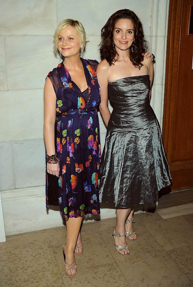 "Mom-to-be Amy Poehler donned a floral chiffon frock, while Tina Fey looked more glamorous than we've ever seen her in this gray strapless number. Dimitrios Kambouris/<a href=""http://www.wireimage.com"" target=""new"">WireImage.com</a> - June 2, 2008"