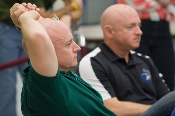 NASA Astronauts Mark Kelly and Scott Kelly, identical twins, are pictured participating in the Joint STS-134, Expedition 25 and Expedition 26 International Space Station Emergency Scenario training. At the time, both Kelly brothers planned to b