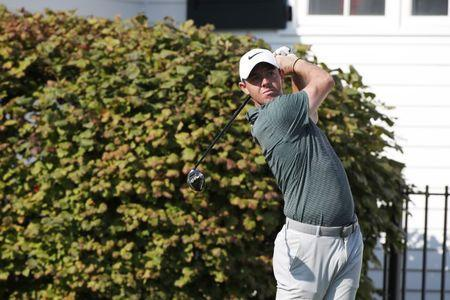 FILE PHOTO: PGA golfer Rory McIlroy tees off on the third hole during the second round of the BMW Championship golf tournament at Conway Farms Golf Club, Sep 15, 2017. Brian Spurlock-USA TODAY Sports