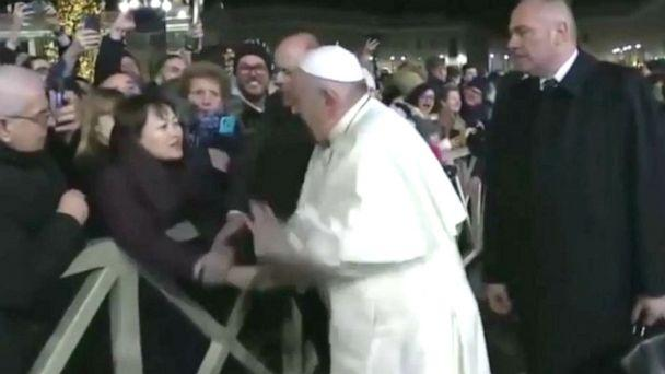 PHOTO: In this still frame from a video, Pope Francis slaps the hand of a woman to free himself after she forcibly grabbed the pontiff and pulled him toward her during a New Year's Eve event in St. Peter's Square, Dec. 31, 2019. (Vatican TV)