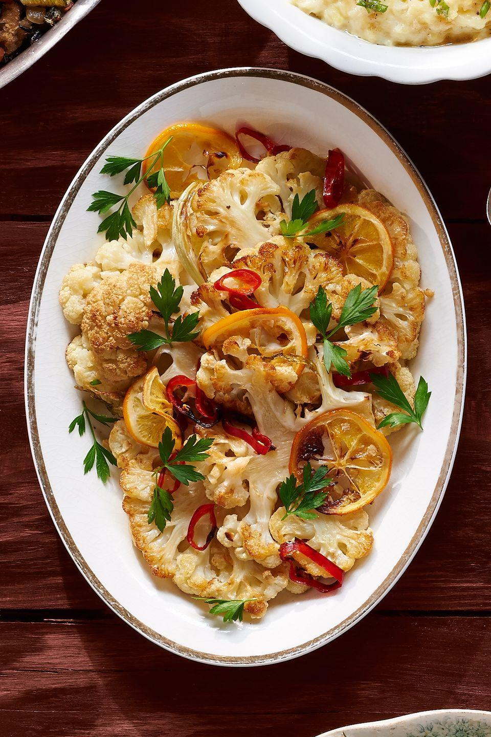 "<p>This spicy and citrusy side is sure to heat up your entire meal.</p><p><strong><a href=""https://www.countryliving.com/food-drinks/recipes/a36667/spicy-lemon-cauliflower/"" rel=""nofollow noopener"" target=""_blank"" data-ylk=""slk:Get the recipe"" class=""link rapid-noclick-resp"">Get the recipe</a>.</strong></p><p><a class=""link rapid-noclick-resp"" href=""https://www.amazon.com/dp/B00INRW7GC?tag=syn-yahoo-20&ascsubtag=%5Bartid%7C10050.g.896%5Bsrc%7Cyahoo-us"" rel=""nofollow noopener"" target=""_blank"" data-ylk=""slk:SHOP BAKING SHEETS"">SHOP BAKING SHEETS</a></p>"