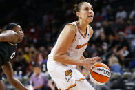 Phoenix Mercury guard Diana Taurasi (3) looks to shoot in front of Las Vegas Aces guard Jackie Young during the first half of Game 5 of a WNBA basketball playoff series Friday, Oct. 8, 2021, in Las Vegas. (AP Photo/Chase Stevens)