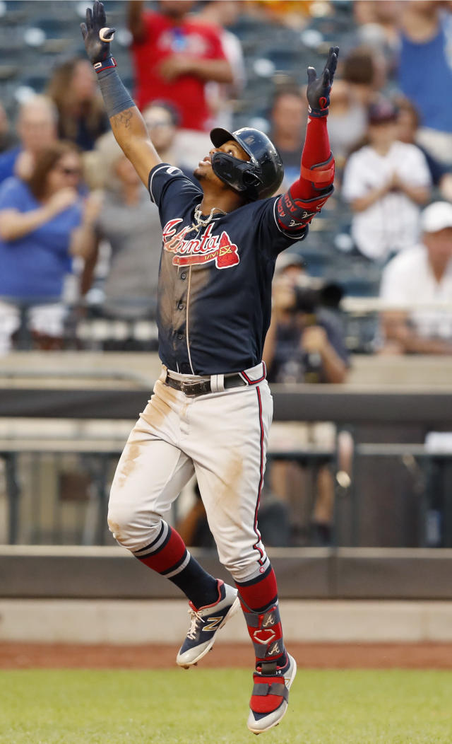 Atlanta Braves' Ronald Acuna Jr. reacts at the plate after hitting a solo home run during the third inning of a baseball game against the New York Mets, Sunday, June 30, 2019, in New York. (AP Photo/Kathy Willens)