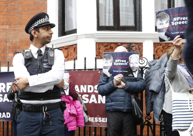 British police arrive and guard the Ecuadorian Embassy as protesters in support of Wikileaks founder Julian Assange demonstrate outside the embassy in London, Monday, May 20, 2019. Swedish authorities on Monday issued a request for a detention order against WikiLeaks founder Julian Assange, who is now jailed in Britain, a Swedish prosecutor said. (AP Photo/Alastair Grant)