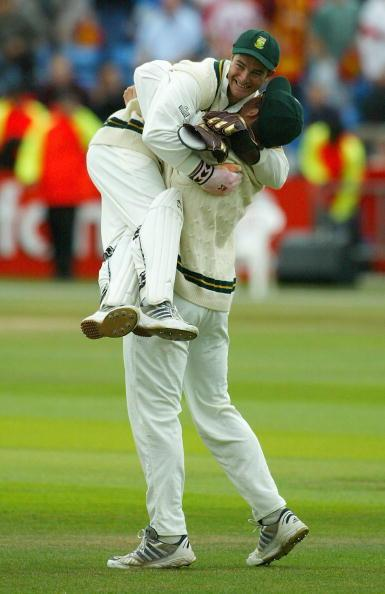 LEEDS, ENGLAND - AUGUST 25:   Graeme Smith of South Africa celebrates with Mark Boucher after South Africa's victory over England on the fifth day of the fourth npower test match between England and South Africa at Headingley Cricket Ground on August 25, 2003 in Leeds, England. (Photo by Paul Gilham/Getty Images)