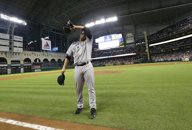New York Yankees starting pitcher Andy Pettitte wipes his face after pitching a complete baseball game against the Houston Astros Saturday, Sept. 28, 2013, in Houston. The Yankees beat the Astros 2-1. Pettitte is retiring at the end of the season.(AP Photo/David J. Phillip)