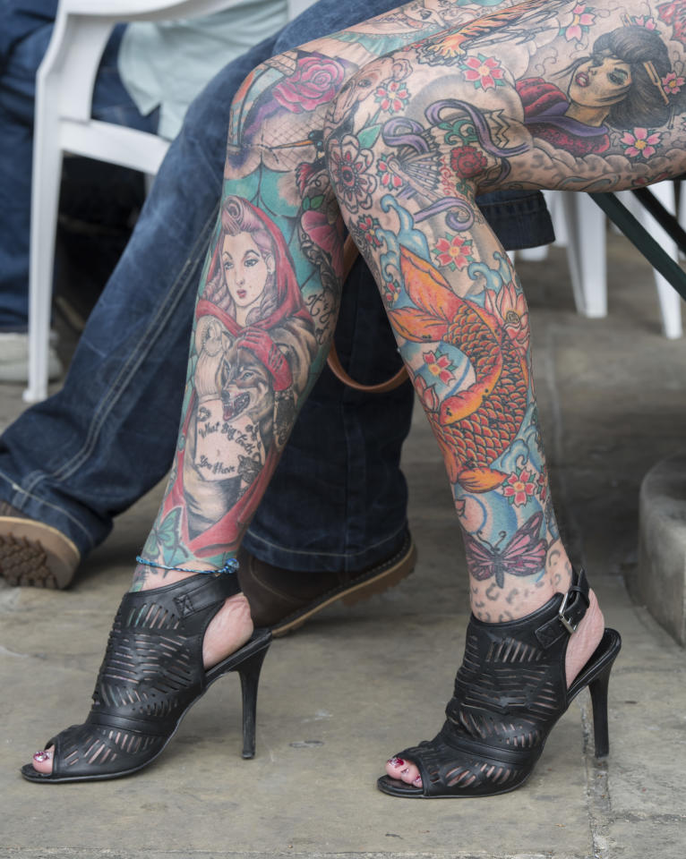<p>A woman's legs at the London Tattoo convention at Tobacco Dock on Sept. 23, 2017 in London, England. (Photo: James D. Morgan/Getty Images) </p>