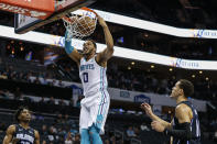 Charlotte Hornets forward Miles Bridges dunks against the Orlando Magic during the first half of an NBA basketball game in Charlotte, N.C., Monday, Feb. 3, 2020. (AP Photo/Nell Redmond)