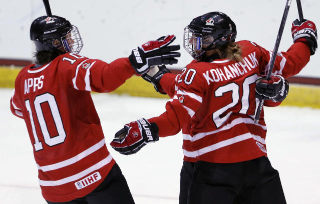 Canada's Jenelle Kohanchuk (20) celebrates her goal against Finland with teammate Canada's Gillian Apps (10) during the first period of a Four Nations Cup women's championship hockey game on Saturday, Nov. 9, 2013, in Lake Placid, N.Y. (AP Photo/Mike Groll)