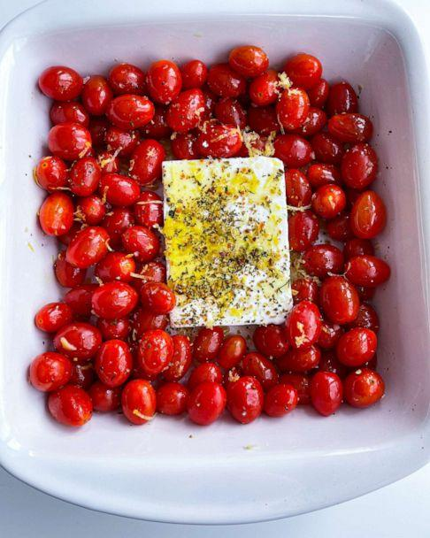 PHOTO: Tomatoes, feta cheese, herbs, olive oil and lemon zest ready to be roasted in the oven. (Everything Delish)