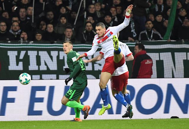 Soccer Football - Bundesliga - Werder Bremen vs Hamburger SV - Weser-Stadion, Bremen, Germany - February 24, 2018 Hamburg's Kyriakos Papadopoulos in action with Werder Bremen's Maximilian Eggestein REUTERS/Fabian Bimmer DFL RULES TO LIMIT THE ONLINE USAGE DURING MATCH TIME TO 15 PICTURES PER GAME. IMAGE SEQUENCES TO SIMULATE VIDEO IS NOT ALLOWED AT ANY TIME. FOR FURTHER QUERIES PLEASE CONTACT DFL DIRECTLY AT + 49 69 650050