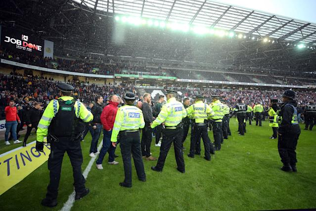 Police and security contain Mansfield fans after a match at Milton Keynes Dons. (Photo by Bryn Lennon/Getty Images)