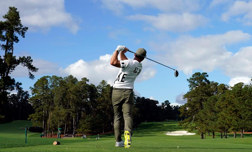 After some early-morning rain, blue skies prevailed as Paul Casey hit this tee shot on the eighth hole during Thursday's first round of the Masters at Augusta National.