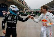 Valtteri Bottas, left, won while Max Verstappen took the title lead by finishing second