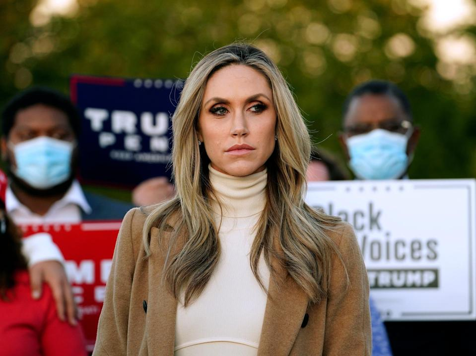 <p>Lara Trump, daughter-in-law of Donald Trump listens to Rudy Giuliani speak during a news conference on legal challenges to vote counting in Pennsylvania earlier this month</p> (AP)