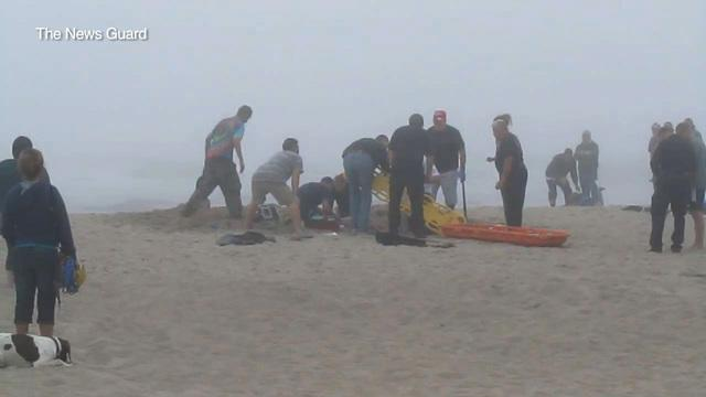 Rescuers try to dig girl out of Oregon sand cave
