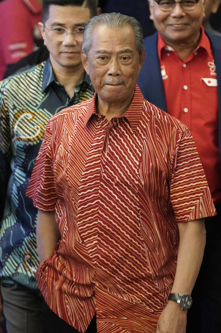 In this Feb. 23, 2020, photo, Muhyiddin Yassin, president of Malaysian United Indigenous Party walks out after a private meeting at a hotel in Kuala Lumpur, Malaysia. Bersatu party said in a statement Friday, Feb. 28, 2020 that 36 lawmakers, including nearly a dozen who defected from Anwar Ibrahim's party, have decided to support party President Muhyiddin Yassin instead of Mahathir as prime minister. (AP Photo/Vincent Thian)