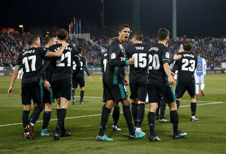 Soccer Football - Spanish King's Cup - Leganes vs Real Madrid - Quarter-Final - First Leg - Butarque Municipal Stadium, Leganes, Spain - January 18, 2018 Real Madrid's Marco Asensio celebrates scoring their first goal with Raphael Varane and teammates REUTERS/Susana Vera