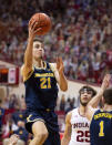 Michigan guard Franz Wagner (21) drives to the basket during the first half of an NCAA college basketball game against Indiana, Saturday, Feb. 27, 2021, in Bloomington, Ind. (AP Photo/Doug McSchooler)