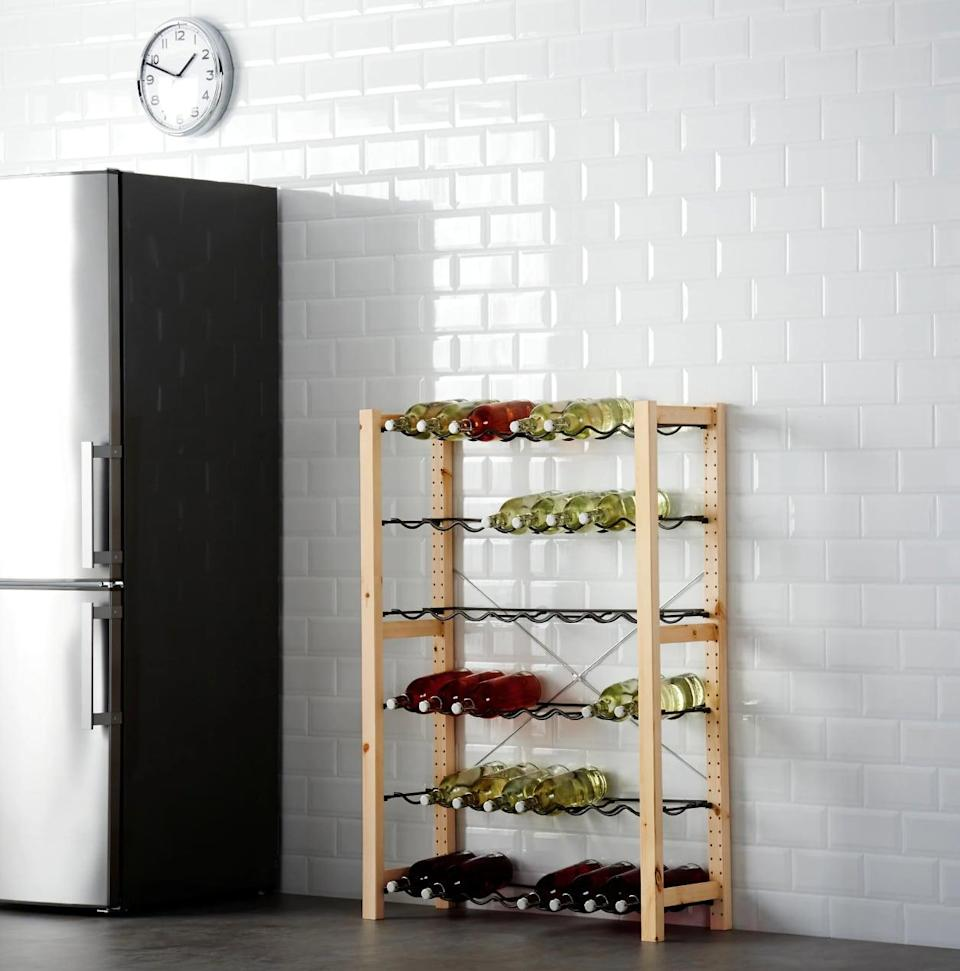 "<p>Place wine, water, juices, and other liquid favorites on the <a href=""https://www.popsugar.com/buy/Ivar%20Shelving%20Unit%20With%20Bottle%20Racks-447013?p_name=Ivar%20Shelving%20Unit%20With%20Bottle%20Racks&retailer=ikea.com&price=69&evar1=casa%3Aus&evar9=46151613&evar98=https%3A%2F%2Fwww.popsugar.com%2Fhome%2Fphoto-gallery%2F46151613%2Fimage%2F46152203%2FIvar-Shelving-Unit-Bottle-Racks&list1=shopping%2Cikea%2Corganization%2Ckitchens%2Chome%20shopping&prop13=api&pdata=1"" rel=""nofollow noopener"" target=""_blank"" data-ylk=""slk:Ivar Shelving Unit With Bottle Racks"" class=""link rapid-noclick-resp"">Ivar Shelving Unit With Bottle Racks</a> ($69).</p>"