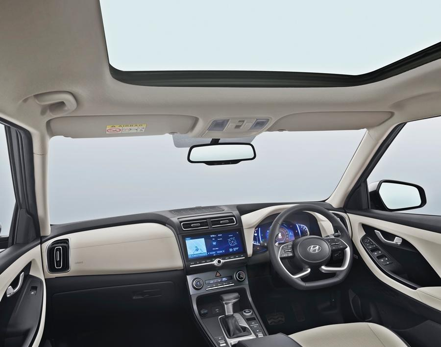 Step inside and the Creta brings in an air of a much more premium SUV. Depending on the engine you can choose from either an all black look or a dual-tone colour. There is a new look steering wheel, leatherette upholstery, more premium looking gear lever and a bigger touchscreen. Even the dials are fancier digital ones.