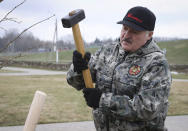 FILE - In this Saturday, April 17, 2021 file photo, Belarus President Alexander Lukashenko plants young trees during a subbotnik, a Soviet-style Clean-up Day, in the village of Alexandria, Belarus. Political prisoners in Belarus are coming under increasing pressure following the recent arrest of activist Raman Pratasevich from a forcibly diverted Ryanair flight. Human rights groups say these prisoners have been marked with yellow tags sewn into their prison uniforms to single them out from regular prisoners. (Maxim Guchek/BelTA Pool Photo via AP, File)
