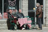 <p>Sirico kicks up his feet, as he discusses a scene with Gandolfini and the show's creator, David Chase. </p>