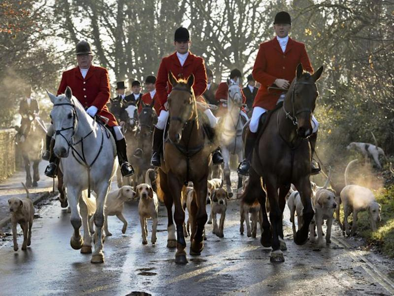 Avon Vale hunt making its way to the village of Laycock, Wiltshire (PA)