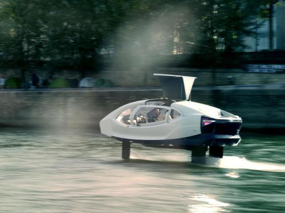 The Sea Bubbles, aka 'flying taxi', cruises on the river Seine during tests in Paris on 16 September, 2019 (AFP/Getty Images)