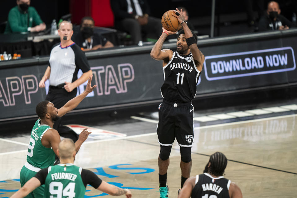 Brooklyn Nets guard Kyrie Irving (11) shoots during the second half of Game 1 of an NBA basketball first-round playoff series against the Boston Celtics Saturday, May 22, 2021, in New York. (AP Photo/Corey Sipkin)