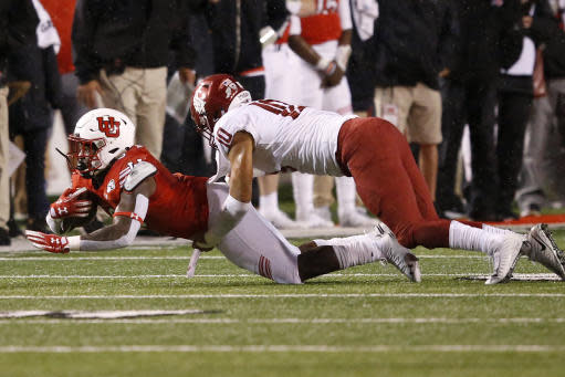 Washington State linebacker Ron Stone Jr. (10) tackles Utah running back Devin Brumfield, left, in the first half of an NCAA college football game Saturday, Sept. 28, 2019, in Salt Lake City. (AP Photo/Rick Bowmer)