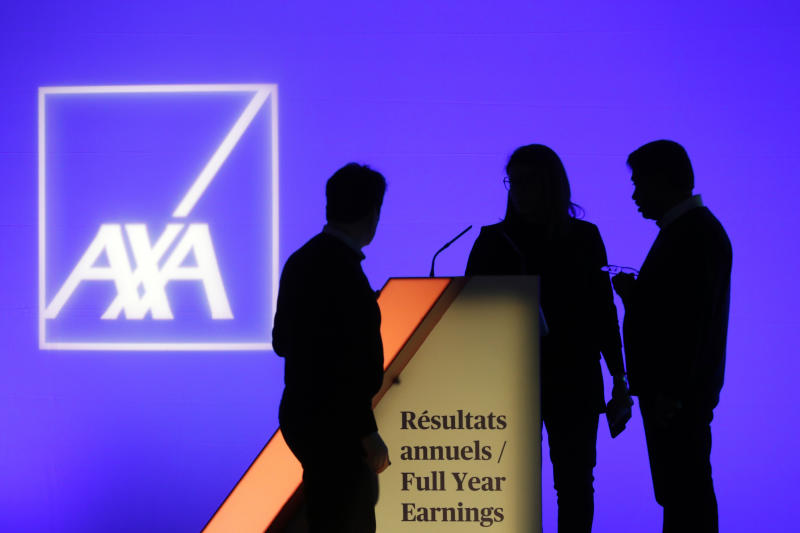 People stand in front of the logo of AXA Group prior to the company's 2018 annual results presentation, in Paris, France, Thursday, Feb. 21, 2019. (AP Photo/Thibault Camus)