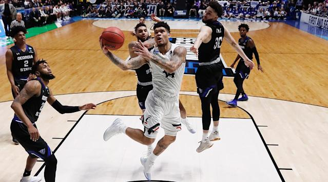 "<p>The first full day of the NCAA tournament is in the books, and Thursday's slate, while light on upsets, was high on drama and close finishes. <a href=""https://www.si.com/college-basketball/2018/03/16/ncaa-tournament-arizona-loses-buffalo-sean-miller-deandre-ayton"" rel=""nofollow noopener"" target=""_blank"" data-ylk=""slk:Arizona was the highest seed to fall"" class=""link rapid-noclick-resp"">Arizona was the highest seed to fall</a>, blown out by Buffalo in Boise, and <a href=""https://www.si.com/college-basketball/2018/03/15/loyola-chicago-ramblers-donte-ingram-sister-jean-ncaa-tournament-tennessee"" rel=""nofollow noopener"" target=""_blank"" data-ylk=""slk:Loyola-Chicago sent Miami home with a last-second three"" class=""link rapid-noclick-resp"">Loyola-Chicago sent Miami home with a last-second three</a>. Now what's in store for Friday? Before No. 1 overall seed Virginia tips off tonight, the defending national champs begin their repeat bit when North Carolina hosts Lipscomb. Later on, top NBA prospects Mo Bamba (Texas) and Michael Porter Jr. (Missouri) make their tournament debuts in Nashville.</p><p>Below you'll find recaps of every game of the first round's second day, along with a full schedule and TV guide for a look at what's ahead. Follow along for results and updates on all of the games as the final buzzer sounds, and <a href=""https://www.si.com/college-basketball/ncaa-mens-basketball-bracket"" rel=""nofollow noopener"" target=""_blank"" data-ylk=""slk:click here for a live look at the bracket."" class=""link rapid-noclick-resp"">click here for a live look at the bracket.</a></p><h3>Friday's Results</h3><h3><strong>Texas A&M 73, Providence 69</strong></h3><p>The SEC has extended its record in this year's first round to 5–0 after Friday's first game, which found a measure of continuity at last down the stretch. Texas A&M missed its first 10 shots of the game, needing over six minutes of action to score, but the Friars failed to take advantage, trailed by one at halftime and ultimately couldn't find the firepower once the Aggies started hitting shots. A&M's two best pro prospects Robert Williams and Tyler Davis dominated inside, combining for 29 rebounds and 27 points.</p><h3><strong>Purdue 74, Cal State Fullerton 48</strong></h3><p>No. 2-seed Purdue looked a little bit rusty early—perhaps expected given the long layoff since their loss in the Big Ten final to Michigan more than 10 days ago—but the Boilermakers locked in after the half. The Edwards combo of Vincent and Carsen (no relation) finished with 15 points each, but Boilermakers big man Isaac Haas took a hard fall and left the court with ice on his elbow. Purdue awaits the Arkansas-Butler winner.</p><h3>Marshall 81, Wichita State 75</h3><p>A gripping second-half three-point shootout (with several exhausting breaks for replay reviews at the scorer's table) ended with the Thundering Herd's first NCAA tournament win in six tries, the second 13-4 upset of the first round. Locked in a showdown with Shockers sharpshooter Conner Frankamp, Marshall junior Jon Elmore scored 27 points and drew the attention of the Wichita State defense away from Ajdin Penava for a dunk off an inbounds play with 34 seconds left, and the Shockers' shots from outside finally stopped falling.</p><h3><strong>Cincinnati 68, Georgia State 53</strong></h3><p>Cincinnati entered Friday's game as a top 2-seed for the first time since 2002, when it was knocked out in the first round, while No. 15 Georgia State was no stranger to winning NCAA tournament games as a double-digit seed. Ron Hunter's upset-minded squad hung with the defensive-minded Bearcats for the first half, but the AAC champs pulled away in the second half, thanks in part to Gary Clark's fourth-straight double-double performance, and in part to the Panthers going cold in the last minutes of the game.</p><h3><strong>North Carolina 84, Lipscomb 66</strong></h3><p>The defending national champs are off and running, shrugging off an early volley of three-pointers from a 15-seed making its first NCAA tournament appearance and pulling away late to advance to a Sunday matchup with Texas A&M. Junior guard Kenny Williams continued the hot streak he came out of the ACC tournament on, leading all scorers with 18 points on 6-of-8 shooting from the field.</p><h3><strong>Butler 79, Arkansas 62</strong></h3><p>The SEC undefeated first-round streak in this year's tournament is no more: The Razorbacks were the first team from the conference fall, succumbing to LaVall Jordan's press-heavy squad. At one point in the first half, Butler led 21-1 before Arkansas outscored the Bulldogs 28–7 to even the score. After the break, the Razorbacks put up a fight but Butler ultimately pulled away behind a combined 51 points from Kamar Baldwin and Kelan Martin. On Sunday, the Bulldogs get a Purdue team without senior center Issac Haas, <a href=""https://www.si.com/college-basketball/2018/03/16/purdue-isaac-haas-injury-update-broken-elbow"" rel=""nofollow noopener"" target=""_blank"" data-ylk=""slk:who will miss the rest of the tournament with a fractured elbow"" class=""link rapid-noclick-resp"">who will miss the rest of the tournament with a fractured elbow</a>.</p><h3><strong>West Virginia 85, Murray State 68</strong></h3><p>With senior guard Jevon Carter leading the way, the Mountaineers dictated the pace from start to finish, forcing 16 turnovers and keeping the Racers at arm's length from late in the first half onward. Carter gave the Murray State backcourt fits on the defensive end, finishing with 21 points and six steals. The win set up an all-West Virginia showdown in the Round of 32 after Marshall's upset of Wichita State.</p><h3><strong>Nevada 87, Texas 83</strong></h3><p>If you missed this one, you missed a good one. The Longhorns seemed in control for the majority of the game, but late in the second half the Wolf Pack started to claw their way back from as much as 14 points down. The battle extended into overtime—it was the Longhorns' eighth OT game of the season, a school record and tied for the most in a season in Division I history, but it was Nevada who rose to the occasion and showed experience in the end. With Texas star Mo Bamba fouled out and two minutes to go in OT, Nevada stormed back to grab its first lead since 5-2 in the first half and took it home. The Wolf Pack gets No. 2 Cincinnati on Sunday.</p><h3><strong>Kansas State 69, Creighton 59</strong></h3><p>No. 9 Kansas State led wire-to-wire in a double-digit win over No. 8 Creighton in the South Region. Bluejays star Marcus Foster, who led the team with 20.3 ppg this season, didn't score until halfway through the second half and finished with just five points on 2-for-11 shooting against his former team. Wildcats freshman guard Mike McGuirl was an unlikely hero, coming off the bench to score 17 points and shooting 3 of 5 from three.</p><h3><strong>Michigan State 82, Bucknell 78</strong></h3><p>Miles Bridges scored 29 points to lead No. 3 Michigan State past No. 14 Bucknell. The Bison hung around with the Spartans for much of the first half and were down only four at halftime, but Bridges asserted himself in the second half as MSU pulled away and staved off a late Bison charge. The Spartans shot just 29.4% from three as a team but made up for it by out-rebounding Bucknell by 12 and limiting its turnovers to 10.</p><h3><strong>Auburn 62, Charleston 58</strong></h3><p>Auburn avoided becoming the latest No. 4 seed to be upset by hanging on to beat No. 13 Charleston.? The Tigers shot just 35.6% from the floor, including a 5 for 24 mark from three, but a strong defensive effort forced 21 Cougars turnovers to make up for the lack of offense. Sophomore Mustapha Heron led Auburn with 16 points, adding five rebounds and two steals.</p><h3><strong>Xavier 102, Texas Southern 83</strong></h3><p>No. 1 Xavier overcame an early seven-point deficit to cruise past No. 16 Texas Southern in the first round. The backcourt duo of J.P. Macura and Trevon Bluiett combined to score 55 points, while forward Kerem Kanter added another 24 in the win. Macura made 5 of 6 three-pointers to lead a 45.8% team mark for the Musketeers, who dished out 19 assists in the victory.</p><h3><strong>UMBC 74, Virginia 54</strong></h3><p>What is there to even say?! No. 16 UMBC went out and shocked the world, becoming the first men's No. 16 seed ever to knock off a No. 1 seed. But the Retrievers didn't just beat No. 1 overall seed Virginia—they blew them out by 20. After playing to a first-half tie, they got off to a roaring start in the second and stunned the Cavaliers' No. 1-ranked defense with 53 second-half points. For the game, UMBC shot 12 for 24 from three and were led by Jairus Lyles's game-high 28 points.</p><h3><strong>Friday's schedule</strong></h3><p>9:40 p.m., CBS<br><strong>(11) Syracuse vs. (6) TCU</strong></p><p>9:50 p.m., TBS<br><strong>(9) Florida St. vs. (8) Missouri</strong></p><p>9:55 p.m., truTV<br><strong>(12) New Mexico State vs. (5) Clemson</strong></p>"