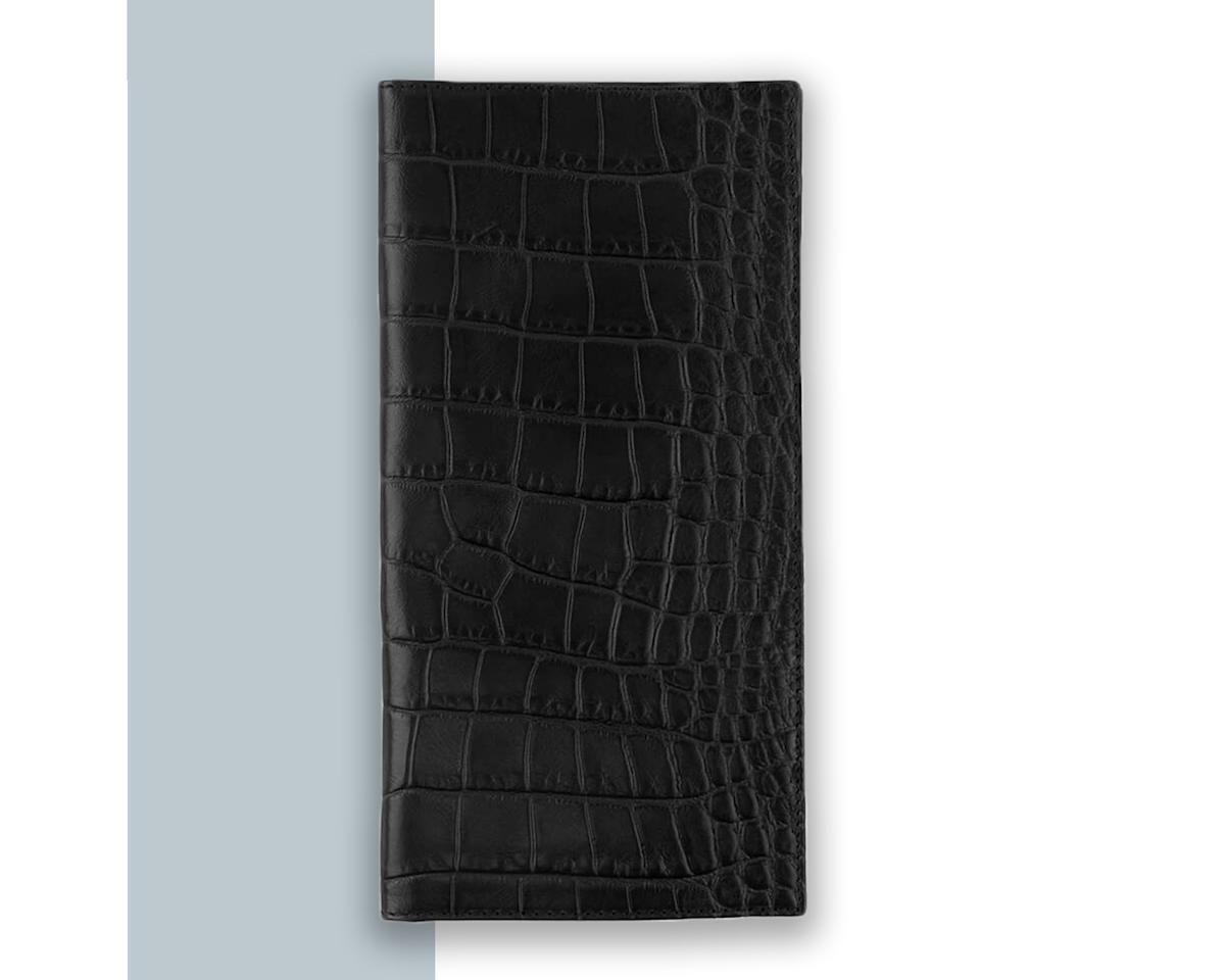 """<p>Traditional passport cases act as protective covers, but this one goes above and beyond its call of duty. Elongated to fit boarding passes and miscellaneous travel documents like baggage receipts, Cuyana's croc-embossed passport case is really a wallet in disguise—it has slots for you to hold credit cards, receipts, IDs, and more.</p> <p><strong>Buy Now</strong>: <a href=""""https://cuyana.64ud.net/xak3R"""" rel=""""nofollow"""" target=""""_blank"""">$125, cuyana.com</a></p>"""