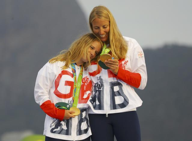 2016 Rio Olympics - Sailing - Victory Ceremony - Women's Two Person Dinghy - 470 - Victory Ceremony - Marina de Gloria - Rio de Janeiro, Brazil - 18/08/2016. Gold medalists Hannah Mills (GBR) of Britain and Saskia Clark (GBR) of Britain pose with their medals. REUTERS/Brian Snyder FOR EDITORIAL USE ONLY. NOT FOR SALE FOR MARKETING OR ADVERTISING CAMPAIGNS.