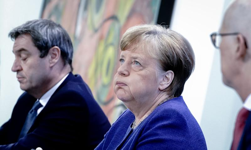 (L-R) Markus Soeder, Bavaria's State Premier, German Chancellor Angela Merkel and Peter Tschentscher, Mayor of Hamburg attend a press conference at the Chancellery in Berlin on April 30, 2020 after holding a telephone conference with the leaders of the Federal states on the restrictions during the novel coronavirus COVID-19 pandemic. (Photo by Kay Nietfeld / various sources / AFP) (Photo by KAY NIETFELD/POOL/AFP via Getty Images)