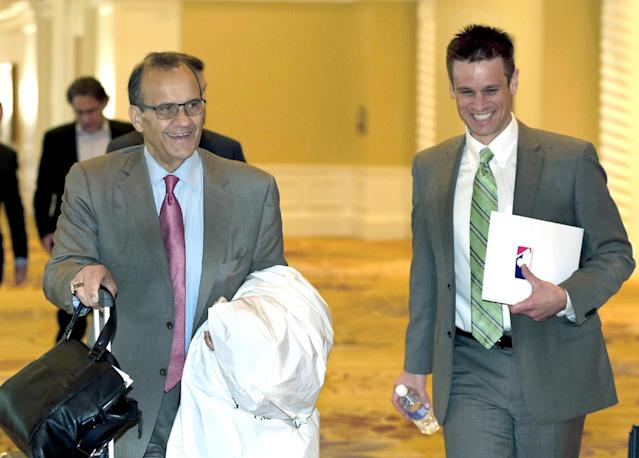 MLB executive vice president Joe Torre, left, and California Angels general manager Jerry Dipoto leave baseball's general managers' meetings Thursday, Nov. 14, 2013, in Orlando, Fla. (AP Photo/Reinhold Matay)