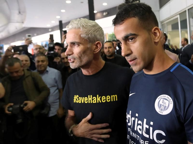 Refugee footballer freed by Thailand returns to Australia
